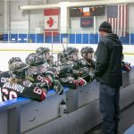 Coach Oostman is talking to the The Chicago Bruins Ice Hockey Gold Team